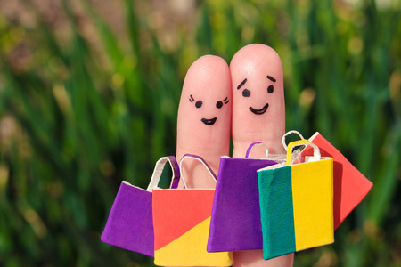 shopaholism: Finger art of a Happy couple with shopping bags