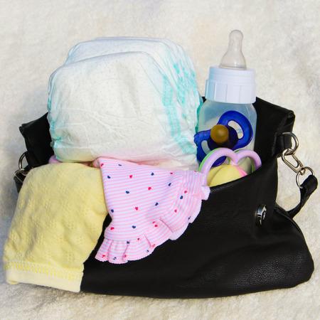 子供の世話をするアイテムをレディース ハンドバッグ