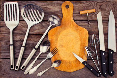 large group of items: kitchen utensils on wooden background. Toned image. Stock Photo
