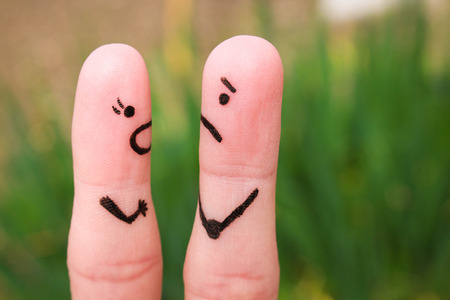 yells: Finger art of a couple during quarrel. A woman yells at a man.