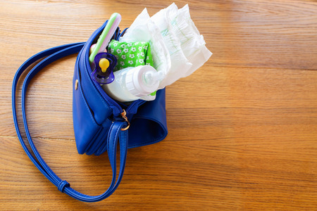 stuff toy: Women handbag with items to care for the child