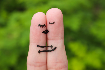 paramour: Finger art of a Happy couple. The happy couple kissing and hugging.