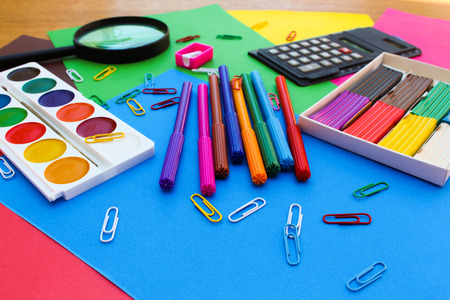 Stationery objects of School and office supplies on the background of colored paper.