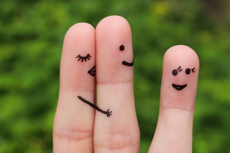 Finger art of a couple. Woman hugs and kisses the man, and he's flirting with another woman. The concept is not shared love.