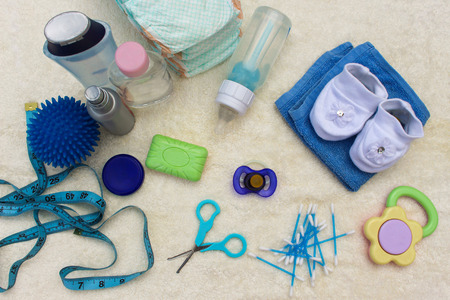 baby blue: Baby accessories: pacifier, bottle, disposable diapers, scissors, funds for the bath, the ball for massage, meter to measure the growth of the child, comb, oil for body