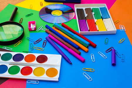 drives: Stationery objects. School and office supplies on the background of colored paper. Stock Photo