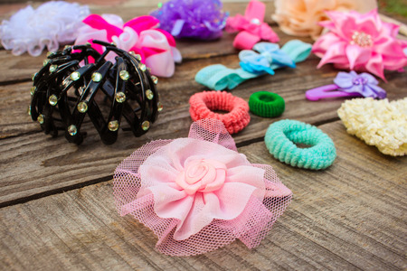 hair clip: Different hair clips on wooden background