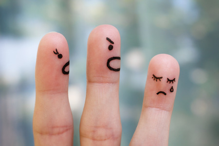 conflict: Finger art of family during quarrel. The concept of parents scolded her daughter, she was crying.