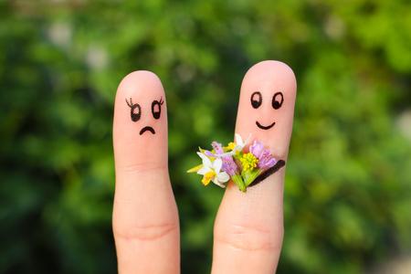 Vinger kunst van het echtpaar. Joyful man geeft een vrouw een boeket van bloemen, het is niet tevreden.