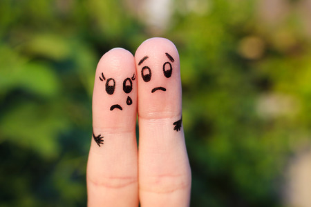 Finger art of displeased couple. Sad man soothe woman, she's crying.