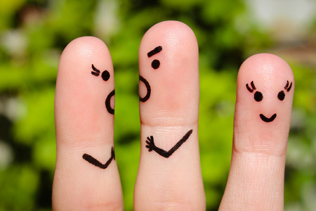 unloved: Finger art of family during quarrel. A couple arguing, another woman is happy.