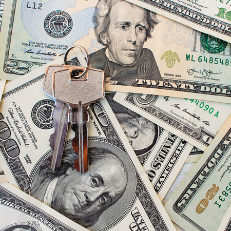 collects: The keys on a background of money.