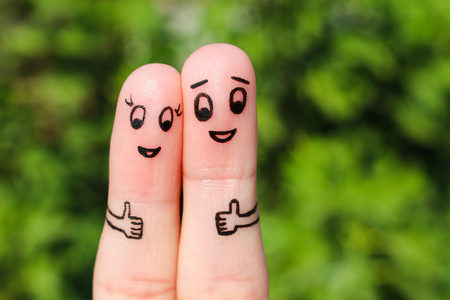 feeling: Finger art of a Happy couple. Happy couple showing thumbs up