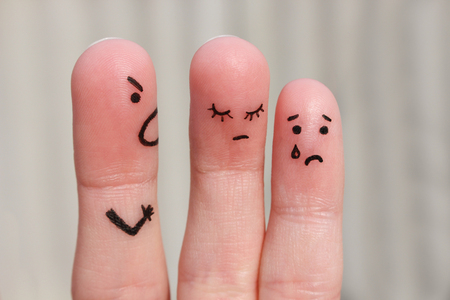fingers: Finger art of family during quarrel. The concept of man scolds his wife and child, woman is sad, baby is crying