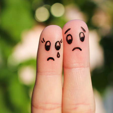 Finger art of displeased couple. Sad man soothe woman, shes crying.