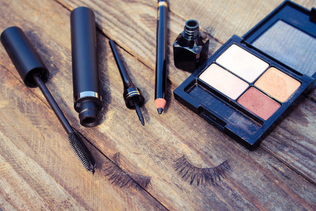 Cosmetics for eyes: pencil, mascara, eyeliner, false eyelashes and eye shadow. Toned image. Stock Photo