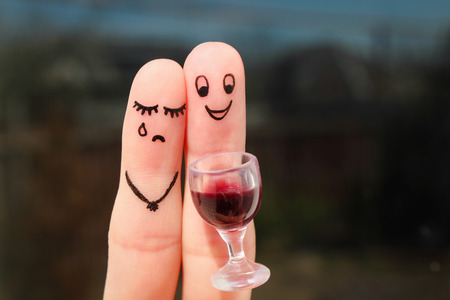 reproach: Finger art of couple. Woman is upset because man drunk. Stock Photo