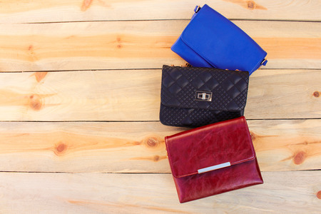 coloured: colored handbags on wooden background Stock Photo