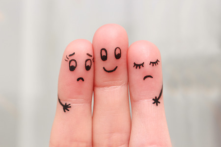unloved: Finger art. Happy man embraces two women, they do not like it. Stock Photo
