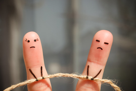 Finger art of couple. Woman and man pull rope. Couple quarreled, can not solve the problem, a misunderstanding.