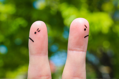 Finger art of couple. Couple after an argument looking in different directions. Stock Photo