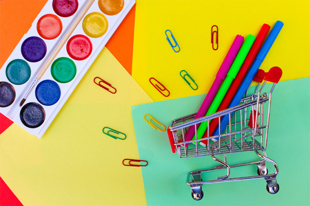 school supplies: Shopping cart with stationery objects. Office and school supplies.