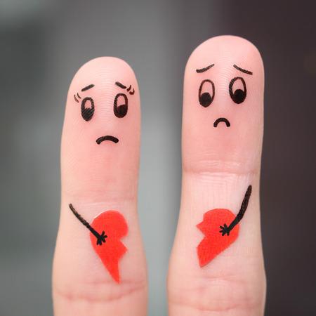 Finger art of couple. Couple holding broken heart. Foto de archivo