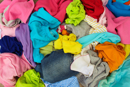 messy clothes: Pile of carelessly scattered clothes. Stock Photo