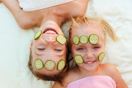 Beautiful girls with facial mask of cucumber.