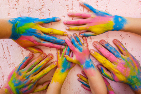 amity: Hands painted in different colors. Concept of love, friendship, happiness in family