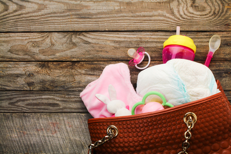 Mother's handbag with items to care for child Standard-Bild