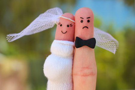 Fingers art of couple. Concept of shotgun wedding. Man was upset because the woman is pregnant and he needs to get married. Stok Fotoğraf - 81430479