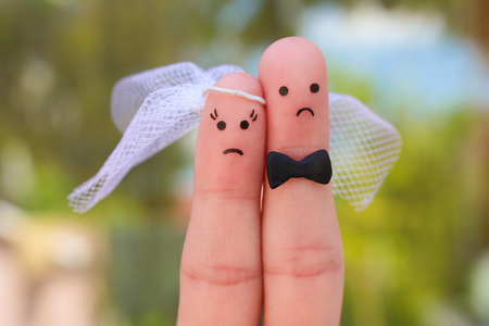 Fingers art of couple. Concept of wedding, woman and man needs to get married, but they do not want. Standard-Bild