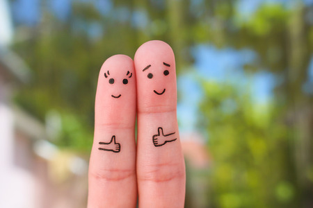 super man: Fingers art of a happy couple showing thumbs up. Stock Photo