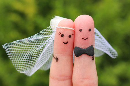 Fingers art of happy couple to get married. Concept of wedding ceremony. Stock Photo