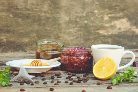 Tea, lemon, mint, jam made of rose petals, honey. Toned image.