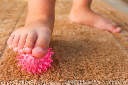 Children do exercise for foot massage ball