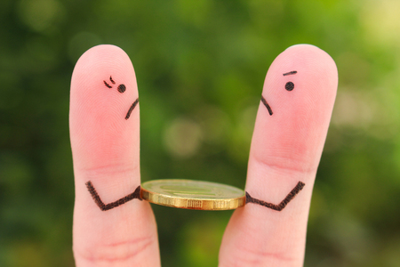 Fingers art of family during quarrel. Concept of man and woman can not divide money after divorce. Imagens