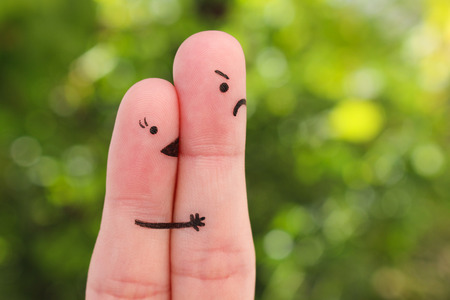 Finger art of couple. Woman kisses man, she do not like him. Concept is not shared love.