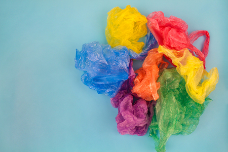 Different plastic bags on blue background. Top view. Stock Photo - 91991804