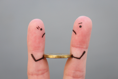 Fingers art of family during quarrel. Concept of man and woman can not divide money after divorce. 写真素材
