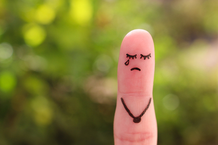 Finger art of lonely woman is crying.