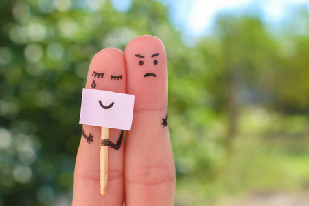 Fingers art of couple. Concept of woman hiding emotions, man is dissatisfied.