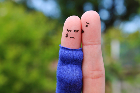 Fingers art of displeased couple. Pregnant cries, man reassures her. He kisses and hugs her. Stock Photo - 117262999