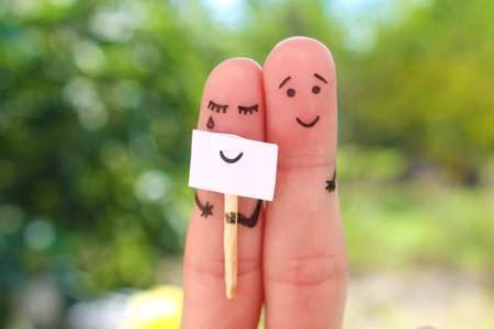 Fingers art of couple. Concept of woman hiding emotions, man is happy. Stok Fotoğraf