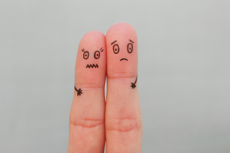 Fingers art of scared couple. Concept of a man and a woman are afraid.