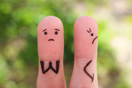 Fingers art of displeased couple. Woman was offended, man asks her forgiveness. Stock Photo - 122587229