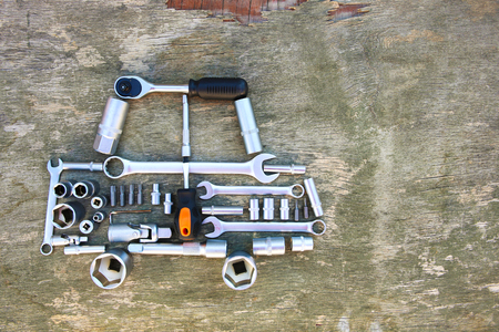 Tool to repair in form of car on wooden background. Top view. Flat lay.