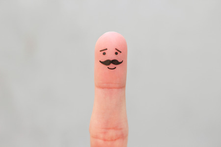 Finger art of happy man with a mustache.