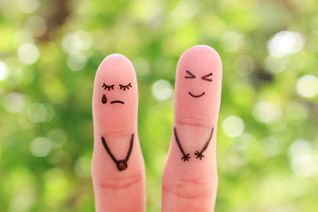 Fingers art of couple. Woman cries, man laughs. Stock Photo
